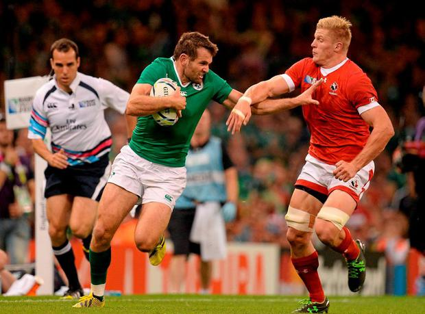Jared Payne, Ireland, is tackled by John Moonlight, Canada. 2015 Rugby World Cup, Pool D, Ireland v Canada. Millennium Stadium, Cardiff, Wales. Picture credit: Brendan Moran / SPORTSFILE