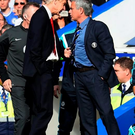Chelsea v Arsenal - Premier League...LONDON, ENGLAND - OCTOBER 05: Managers Arsene Wenger of Arsenal and Jose Mourinho manager of Chelsea clash during the Barclays Premier League match between Chelsea and Arsenal at Stamford Bridge on October 4, 2014 in London, England. (Photo by Shaun Botterill/Getty Images)...S