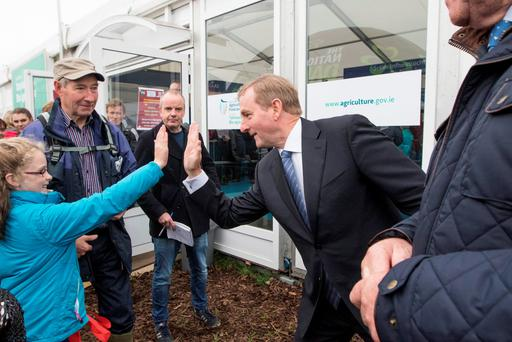 Taoiseach Enda Kenny high fives Fiona Hern from Waterford at the 2015 National Ploughing Championships in Ratheniska, County Laois. Pic: Mark Condren