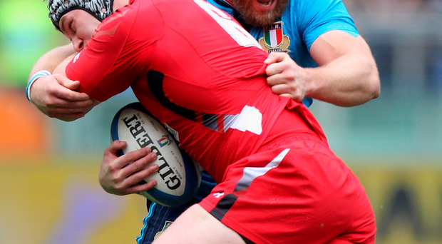 Leonardo Ghiraldini (right) competes for control of the ball with Dan Lydiate of Wales