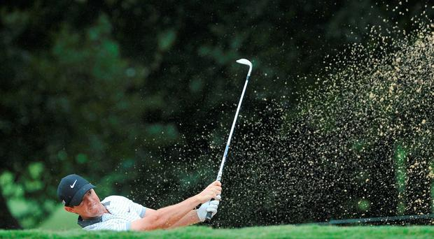 Rory McIlroy plays out of a bunker on the eighth fairway during the second round of the Tour Championship