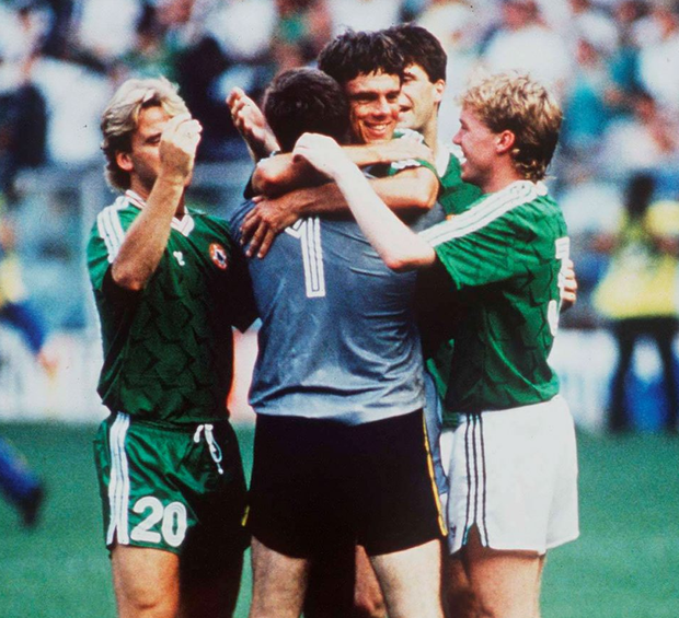 David O'Leary (centre) celebrates with his Ireland teammates after scoring the penalty that beat Romania in the 1990 soccer World Cup