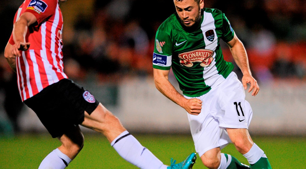 Cork City's Ross Gaynor tries to by-pass Aaron McEneff