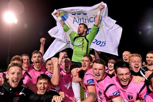 Wexford Youths captain Graham Doyle celebrates with his team-mates after the game.