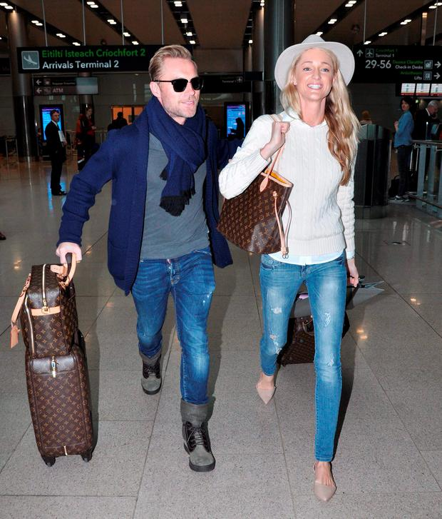Ronan Keating and new wife Storm Keating arriving at Dublin airport,their first visit back to Dublin since getting married last month in Scotland. Picture: John Dardis