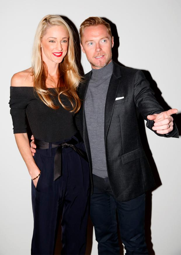 Storm Uechtritz and Ronan Keating attend the Pringle Of Scotland show during London Fashion Week Spring/Summer 2016 on September 20, 2015 in London, England. (Photo by Tristan Fewings/Getty Images)