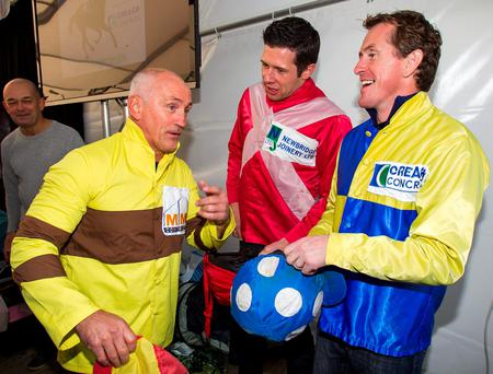 Former WBA Featherweight Champion Barry McGuigan (left) jokes with Tyrone GAA player Sean Cavanagh and champion jockey AP McCoy (right) at a charity donkey derby event in Moneyglass, Co. Antrim Credit: Liam McBurney/PA Wire