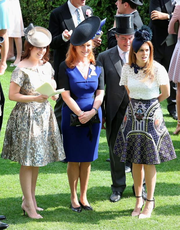 Princess Eugenie Windsor, Princess Beatrice and Sarah Ferguson, Duchess of York hold hands in the parade ring on day 4 of Royal Ascot at Ascot Racecourse on June 19, 2015 in Ascot, England. (Photo by Chris Jackson/Getty Images)