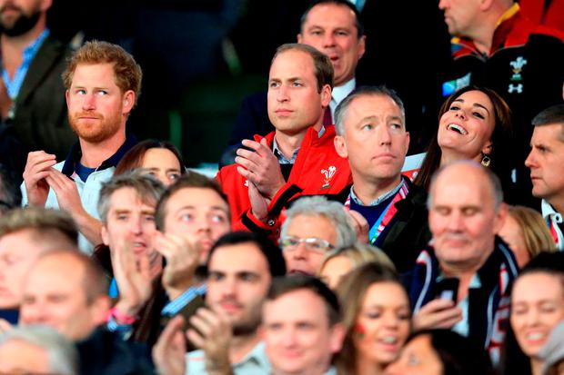 Prince Harry (left) and The Duke of Cambridge Duchess of Cambridge during the Rugby World Cup match at Twickenham Stadium, London.
