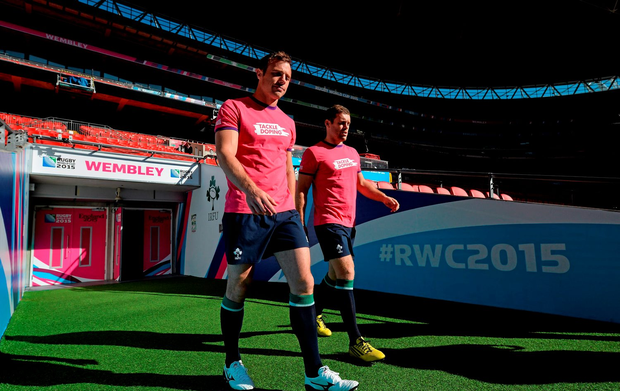 Ireland's Tommy Bowe, left, and Darren Cave make their way out for the captain's run