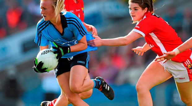 Carla Rowe, Dublin, is tackled by Marie Ambrose, Cork. TG4 Ladies Football All-Ireland Senior Championship Final, Croke Park, Dublin. Picture credit: Ramsey Cardy / SPORTSFILE