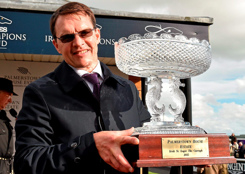 Trainer Aidan O'Brien lifts the trophy after he sent out Order Of St. George to win the Palmerstown House Estate Irish St. Leger. Irish Champions Weekend. The Curragh, Co. Kildare. Picture credit: Cody Glenn / SPORTSFILE
