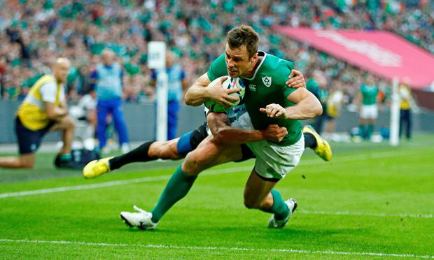 Ireland's Tommy Bowe scores a try