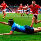 Italy's Carlo Canna fails in attempt to score a try as he puts his left arm in touch before putting the ball down