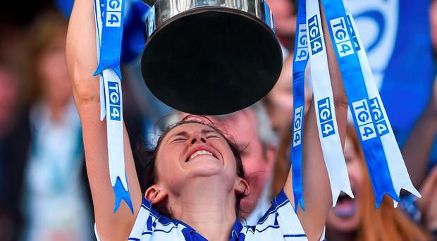 Waterford captain Linda Wall lifts the Mary Quinn Memorial Cup after their victory in the TG4 Ladies IFC final