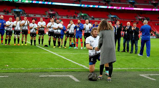Romania's Florin Surugiu proposes to his girlfriend Alexandria after their defeat to Ireland