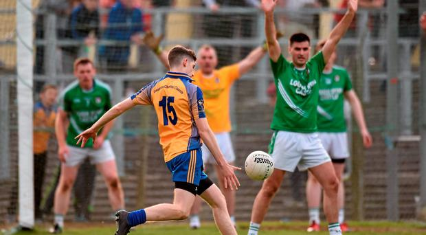 Conor Dolan, Glencar-Manorhamilton, scores his side's equalizing point during injury time against Mohill