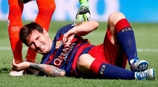 FC Barcelona's Lionel Messi faces at least six to eight weeks on the sidelines
