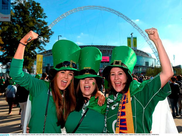 Ireland supporters, from left, Aoife Gath, Claire Regan, and Fenela St John, from Athboy, Co. Meath, ahead of the game