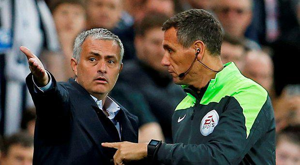 Chelsea manager Jose Mourinho talks with the fourth official Andre Marriner