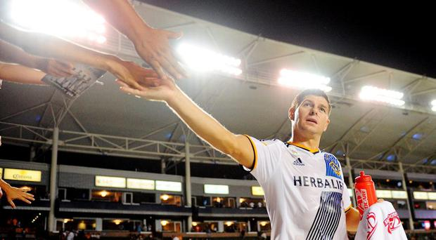 Los Angeles Galaxy midfielder Steven Gerrard (8) greets fans following the 3-2 victory against FC Dallas at StubHub Center. Credit: Gary A. Vasquez-USA TODAY Sports