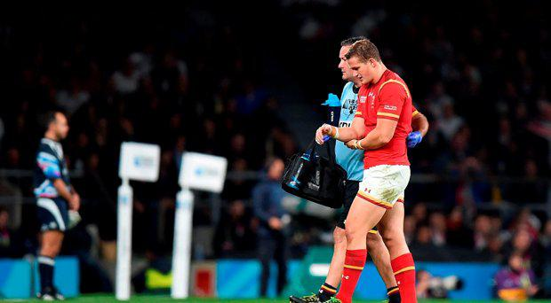Wales' Hallam Amos leaves the field of play with an injury during the Rugby World Cup match at Twickenham Stadium, London