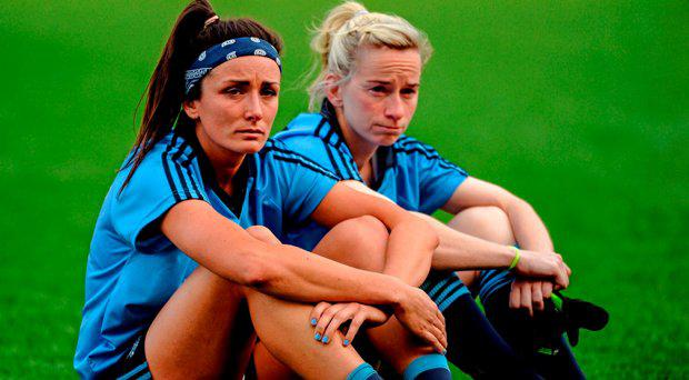 Dejected Dublin players Niamh McEvoy, left, and Sorcha Furlong, watch the presentation from the pitch after the game