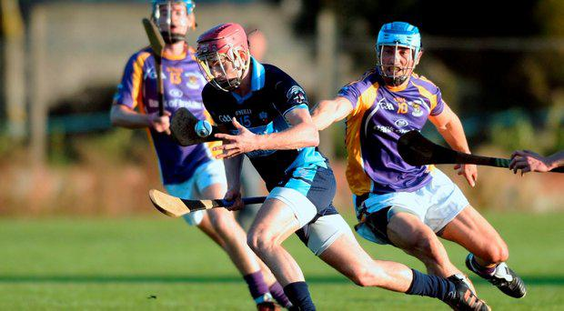 Joe McManus, St. Jude's, in action against Ross O'Carroll, Kilmacud Crokes. Senior Hurling Championship quarter final, St. Judes v Kilmacud Crokes. O'Toole Park, Dublin. Picture: Caroline Quinn
