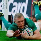 Ireland's wing Keith Earls scores their second try during a Pool D match of the 2015 Rugby World Cup between Ireland and Romania at Wembley