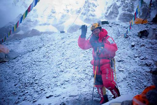 Nobukazu Kuriki waves during his latest attempt to climb Everest