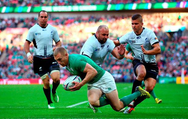 Keith Earls of Ireland scores his teams third try during the 2015 Rugby World Cup Pool D match between Ireland and Romania at Wembley