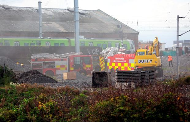 29/09/2015 Dublin Fire Brigade at the scene of a Fire close to the Royal Canal near North Strand in Dublin's north inner city. Irish Rail announced that DART and intercity services have been delayed following the fire.Pic Gareth Chaney /Collins Photos