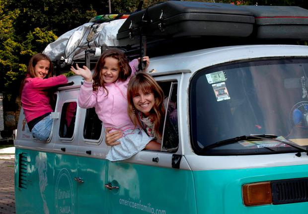 Noel Zemborain (39) poses with two of her children, 12-year-old Cala, left, and 5-year-old Mia, in their 1980 Volkswagen van, which the family named Francisca Credit: AP Photo/Marco Ugarte