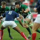 Stephen Ferris, supported by Ronan O'Gara, in action against Thierry Dusautoir, of France in 2010