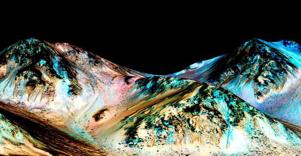 handout image issued by NASA of Mars, as scientists believe that flowing liquid water is almost certainly responsible for mysterious features on Mars that change with the seasons Credit: NASA/JPL/University of Arizona/PA Wire