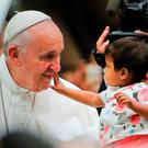 Pope Francis blesses a child during his visit to Philadelphia for the World Meeting of Families