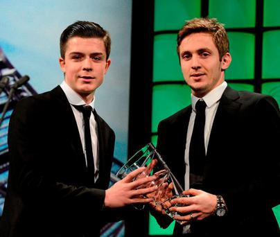 Jack Grealish is presented with the Irish U17 International player of the year award by Kevin Doyle in 2013