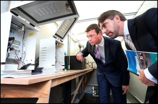 Environment Minister Alan Kelly is shown air measuring equipment by Patrick Kenny, EPA Air Quality Manager, at Dublin City Council's offices, where he outlined plans for a smoky ban nationwide. Photo: Steve Humphreys