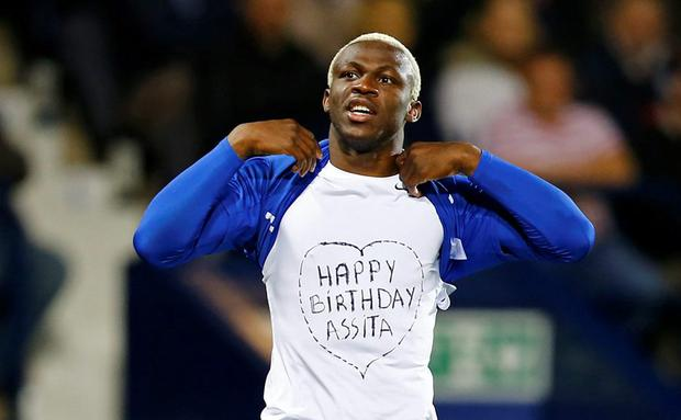 Arouna Kone reveals a message as he celebrates scoring the second goal for Everton