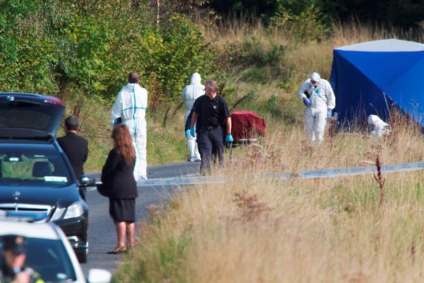 Mr Mulligan's remains are removed from the scene