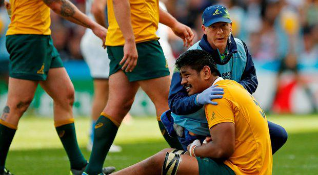 Australia's Will Skelton receives treatment before going off injured