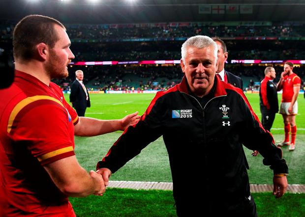 Wales Cooach Warren Gatland shakes hands with Tomas Francis as he walks off the field of play following victory in the 2015 Rugby World Cup Pool A match between England and Wales at Twickenham