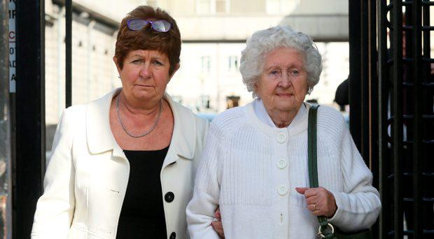 Anne Claxton, leaving court with her mother Anne Rudd (right) after she appeared before the Dublin District Court