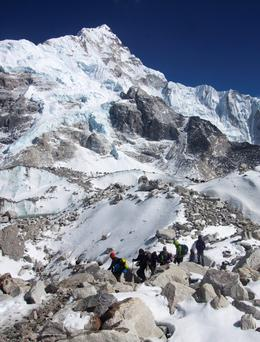 In this March 21, 2015 file photo, trekkers walk towards Everest Base camp, Nepal. (AP Photo/Tashi Sherpa, file)