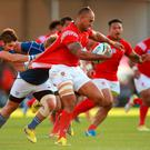 Tonga's Vungakoto Lilo gets away from Namibia's Eneill Buitendag