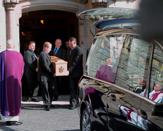 The remains of Judge Paul Carney are carried from the church