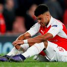 Alex Oxlade Chamberlain is down and almost out at the end of last night's match