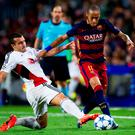 Neymar Santos Jr of FC Barcelona fights for the ball with Guilio Donati of Bayer 04 Leverkusen (Photo by Alex Caparros/Getty Images)