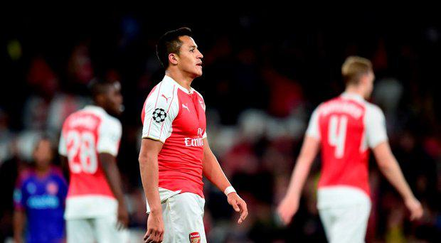Arsenal's Alexis Sanchez (left) dejected during the UEFA Champions League, Group F match at The Emirates Stadium