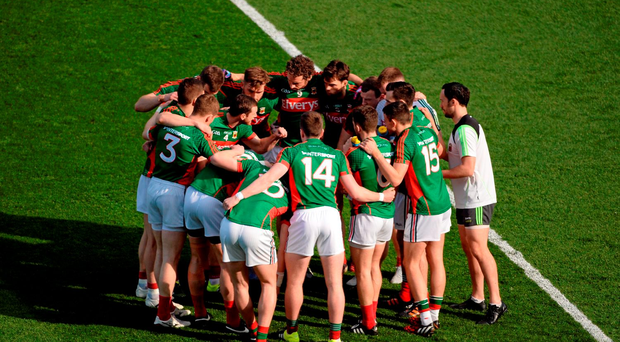 Mayo captain Keith Higgins speaks to his team before the Dublin game